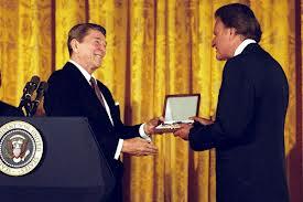 BG accepting medal